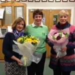 Susan Crawford & Margaret Hayes receiving Flowers from Our Lady Captain June Abernethy